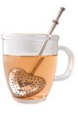 A tea cup with the tea infuser