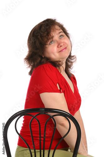 Photo: Chubby girl sits on stool thinking.