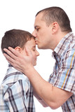 Father kissing his son on the forehead poster