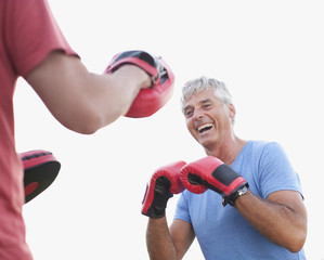 Laughing boxer training with sparring partner