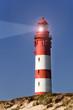 Leinwandbild Motiv Leuchtturm in der Dämmerung