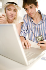 Couple using credit card for internet purchase