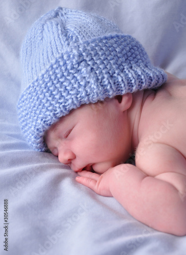 Newborn Baby Sleeping on Blue