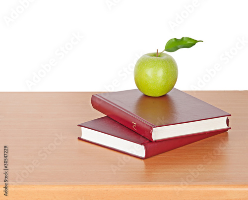 apple and books on desk