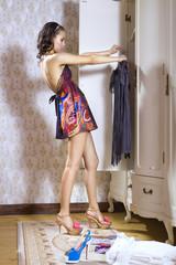 woman looks on dress