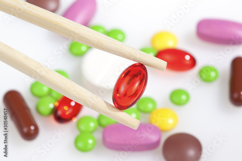 chopsticks keep a bright red pill