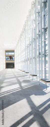 Glass corridor walls in modern office building