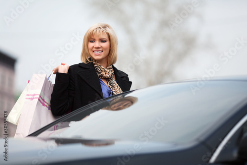 Young shopper on the car parking