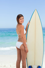 Pretty woman with her surfboard
