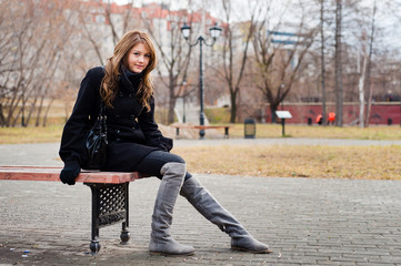 photo of a girl sitting on the bench