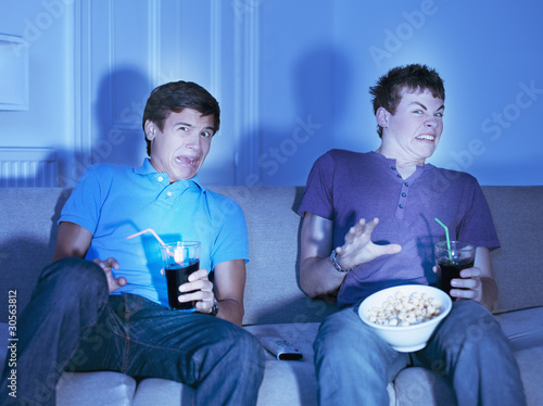 Teenage boys watching scary movie