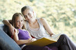 Mother and daughter reading storybook together