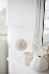 Close up of white decorations on living room mantelpiece