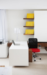 """Laptop, desk and chair in modern office"""