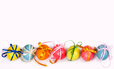 Colored eggs with bows