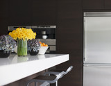 Stainless steel refrigerator in modern kitchen