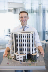 Architect holding building model