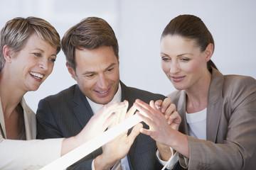 Business people touching glowing light