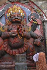 Woman praying at Kali in Kathmandu , Nepal 1.