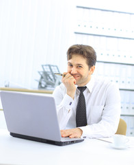 Closeup of employee in the office working on laptop