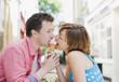 Couple sharing ice cream cone