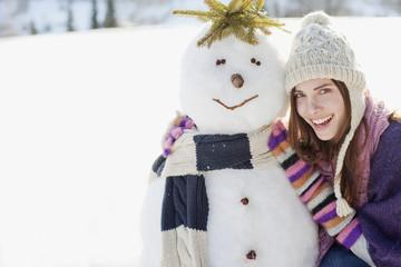 Woman hugging snowman