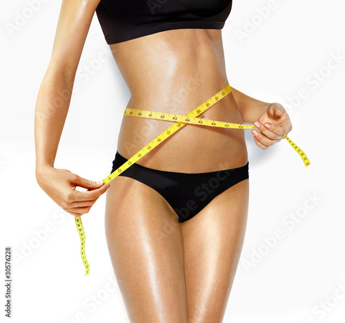 beautiful woman measuring perfect shape