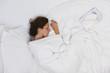 Sick woman sleeping in bed