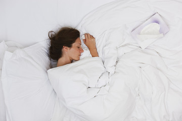 Sick woman sleeping in bed