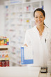 Pharmacist holding prescription in drug store