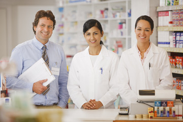 Smiling pharmacists in drug store