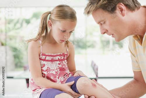Father tending to daughter?s scraped knee