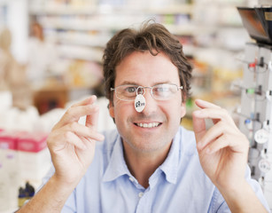 Customer trying in prescription eyeglasses in drug store