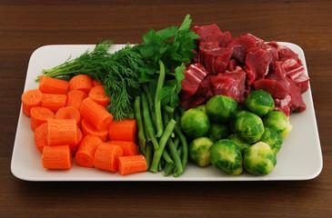 Colorful ragout ingredients on rectangular grey ceramic dish