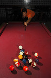 Person playing snooker