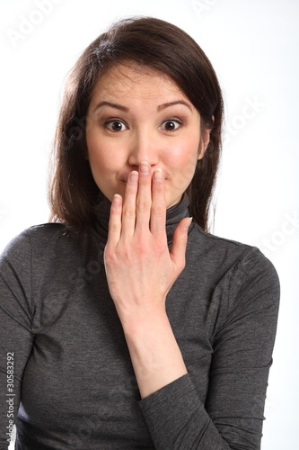 Oops hand signal by pretty young woman with hand over mouth