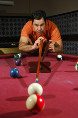 Person playing snooker (focus on the player)