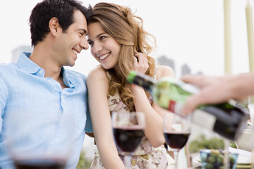 Couples enjoying party on balcony