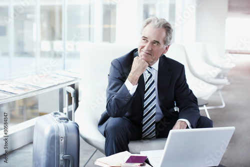 Businessman using laptop while traveling
