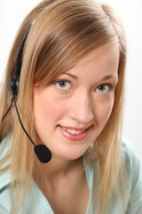 Blonde customer service woman on telephone headset