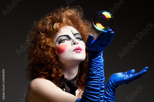 woman mime with soap bubbles.