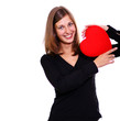 attractive young woman holding a red heart over white background