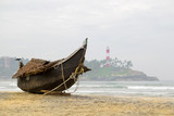 Traditional wooden fishing boat on Kovalam beach, Kerala, India