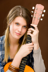 Rock musician - fashion woman holding guitar