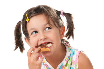 Little girl biting a snack