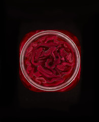 Close up of red pickled cabbage in jar