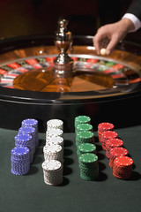 Gambling chips and roulette wheel