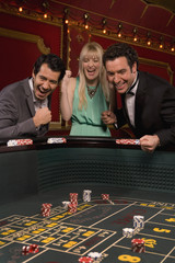 Excited friends winning at craps table