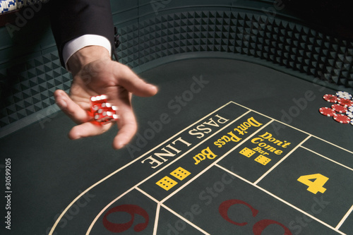 Man throwing dice at craps table