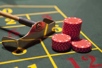 Close up of gambling chips on gaming table